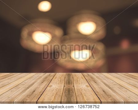 Wooden board empty table in front of blurred background. Perspective brown wood over blur in coffee shop - can be used for display or montage your products.Mock up for display product.Vintage filter.
