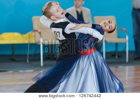 Minsk Belarus -April 3 2016: Prahov Ivan and Sapkevich Ekaterina Perform Youth-2 Standard Program on the IDSA Championship Kinezis Star Cup in April 3 2016 in Minsk Republic of Belarus