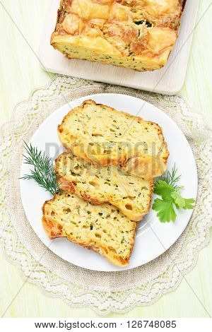 Slices of vegetable moist bread with zucchini cheese eggs carrot top view