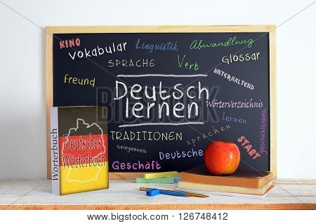 Blackboard in a German language classroom with the message LEARN GERMAN and some text