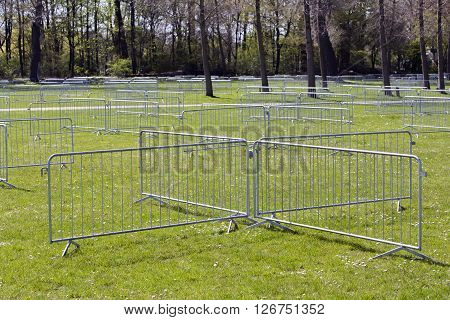 Metal security barriers to divide the area for safety