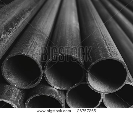 Folded grey industrial plastic tubes closeup background