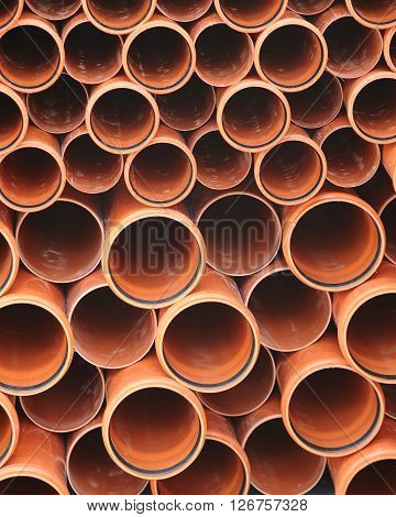 Folded brown industrial plastic tubes circles background