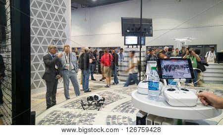 LAS VEGAS - April 18, 2016: DJI Phantom 4 quad copter drone remote controlled flight demonstration at DJI booth at NAB 2016 in Las Vegas Convention Center.