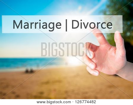 Marriage  Divorce - Hand Pressing A Button On Blurred Background Concept On Visual Screen.