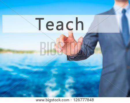 Teach - Businessman Hand Pressing Button On Touch Screen Interface.