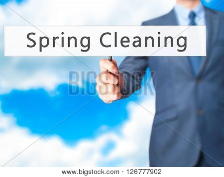 Spring Cleaning - Businessman Hand Holding Sign