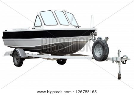 Motor boat on the trailer for transportation is isolated on a white background.