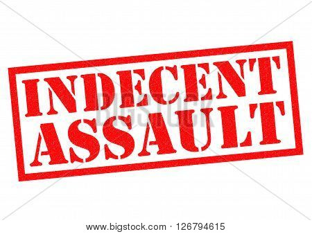 INDECENT ASSAULT red Rubber Stamp over a white background.