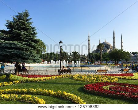 View across flower gardens in Sultanahment Park to the landmark Blue Mosque (Sultan Ahmed Mosque) in Istanbul, Turkey