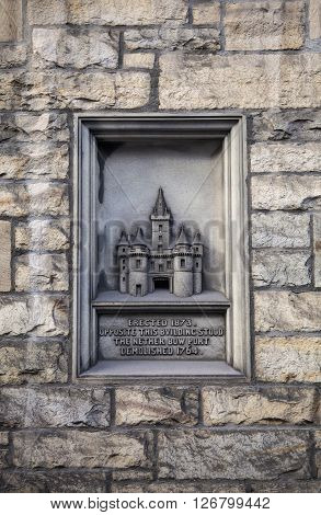 A carving on The Royal Mile in Edinburgh marking the location where the Netherbow Port once stood.