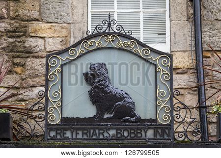 EDINBURGH SCOTLAND - MARCH 9TH 2016: The sign above the Greyfriars Bobby public house on Candlemaker Row in Edinburgh on 9th March 2016.