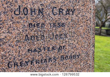 EDINBURGH SCOTLAND - MARCH 11TH 2016: A close-up of the grave of John Gray in Greyfriars Cemetery in Edinburgh on 11th March 2016. John Gray was the owner of the famous Greyfriars Bobby dog.