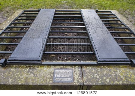 An iron cage (known as a mortsafe) covering a grave in Greyfriars Cemetery in Edinburgh Scotland. Mortsafes were used in the 19th century to prevent bodysnatchers from stealing corpes.