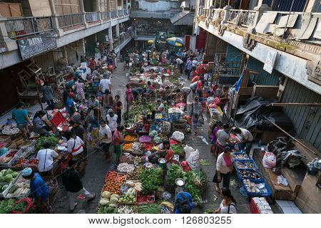 BALI, INDONESIA - MARCH 16, 2016: View of the commercial and trading activities in the morning on the ground floor of the main market in Ubud town on Bali Island.