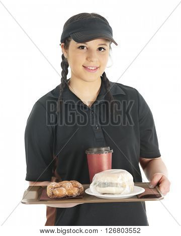 A pretty young waitress bringing the viewer a wrapped breakfast sandwich, twisty donut and cup of coffee.  On a white background.