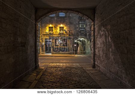 EDINBURGH SCOTLAND - MARCH 8TH 2016: A view from Sugarhouse Close of the historic Tolbooth Tavern along the Royal Mile in Edinburgh on 8th March 2016.