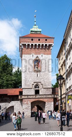 KRAKOW POLAND - MAY 30 2015: Gothic St Florian's Gate (Brama Florianska) in Cracow Poland and walking people