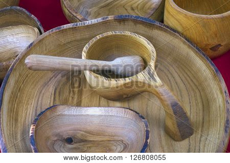 Wooden kitchen dishware handcrafted in rustic style.