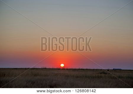 The sun sets in the steppe part of Ukraine