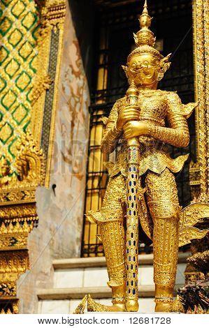 The golden giant statue in Wat Phra Kaew