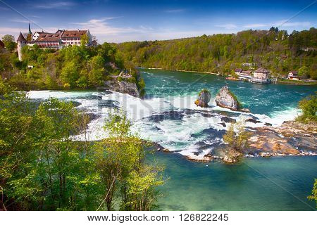 RHINE FALLS SWITZERLAND - April 28 2012 - Vire to Rhine falls near Schaffhausen Switzerland. Rhine falls is the largest plain waterfall in Europe.