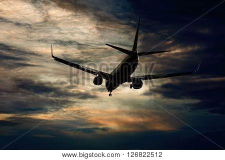 Passenger aircraft flying evening flight