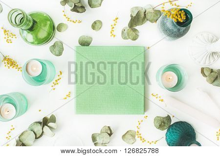 green wedding or family photo album dress with flower pattern candles candlesticks branches leaves and yellow mimosa isolated on white background. flat lay overhead view