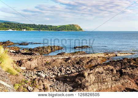 Cliffs and rocks on the Coast of Antrim County in Northern Ireland UK.