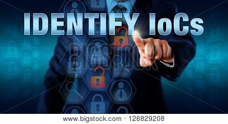 Forensic Investigator is pressing IDENTIFY IoCs on a virtual touch screen interface. Business challenge metaphor and information technology concept for computer forensic identification via artifacts.