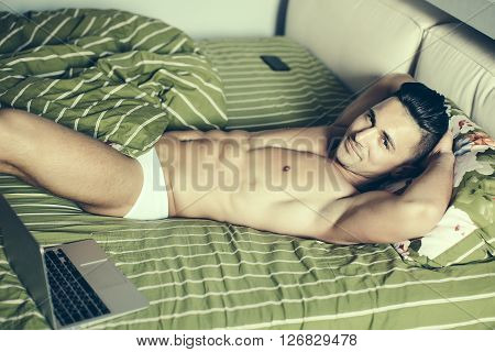 Muscular Man With Laptop