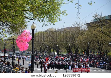 WASHINGTON, DC - APR 16: Marching band and balloon at the 2016 National Cherry Blossom Parade in Washington DC, as seen on April 16, 2016. Thousands of visitors gathered to attend this annual event.