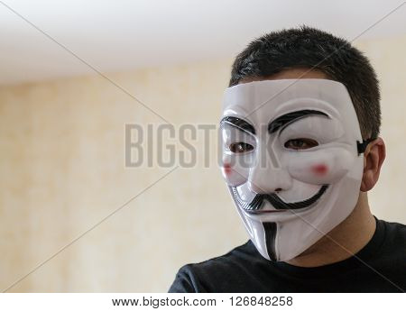 UFA - RUSSIA 8TH MARCH 2016 - Man wears a Guy Fawkes Mask popular with anonymity to disguise his identity in Ufa Russia on the 8th of March 2016