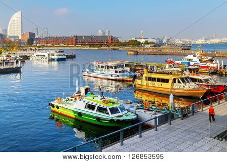 YOKOHAMA JAPAN - NOVEMBER 24 2015: Yokohama Port has 10 major piers. In 2013 the Port served 37706 ships. It handled 271276977 tons of cargo and 2888220 TEU containers
