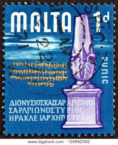 MALTA - CIRCA 1965: a stamp printed in Malta shows Cippus Phoenician and Greek Inscriptions circa 1965
