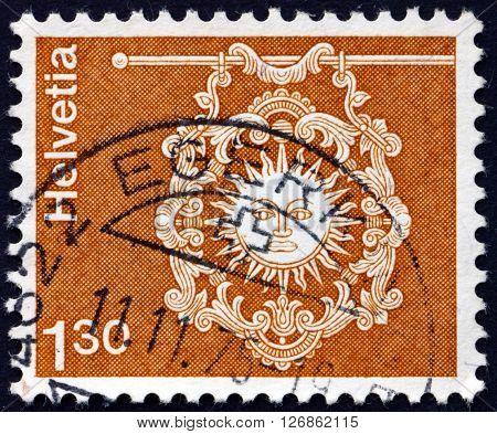 SWITZERLAND - CIRCA 1973: a stamp printed in the Switzerland shows Sign of Inn Zur Sonne Toggenburg circa 1973