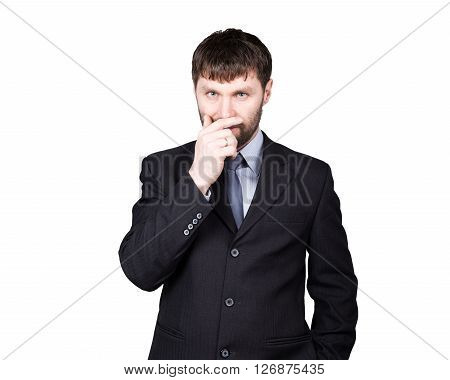 body language. gestures distrust lies. closes mouth by hand, closed position. man in business suit isolated on white background. concept of true or false.