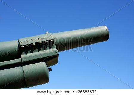 powerfull military artillery gun and blue sky