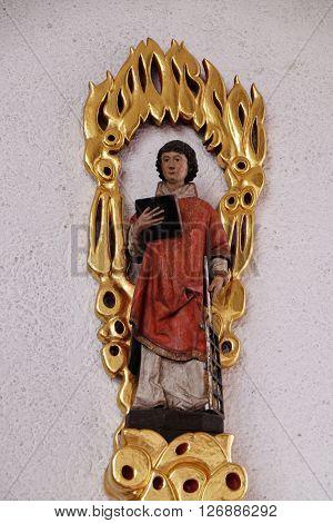 KLEINOSTHEIM, GERMANY - JUNE 08: Saint Lawrence of Rome, Saint Lawrence church in Kleinostheim, Germany on June 08, 2015.