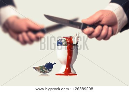 Businessmen destroy the earth with Knifes symbolized by a bleeding egg