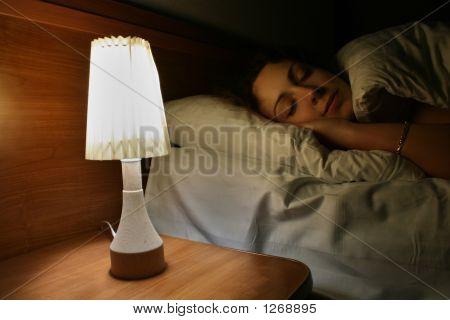 Slapende vrouw met een Lamp
