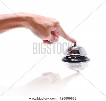 Hand ringing in service bell isolated on whitebackground .