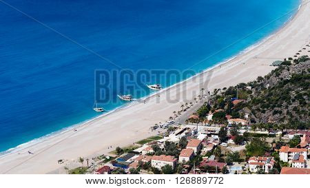 Aerial view of town and beach. Yachts are waiting tourist on the beach. Oludeniz Fethiye Turkey
