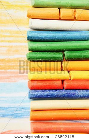The colored dry postels close up background.
