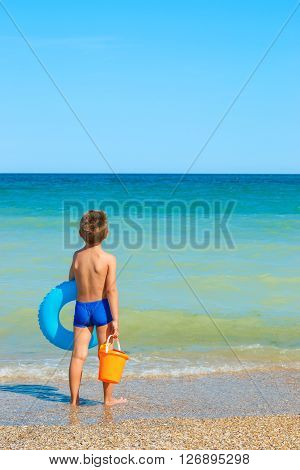 Child With Toys, Looking At The Sea