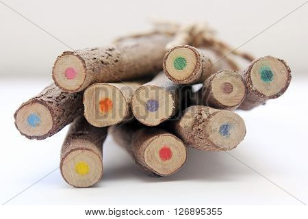 Brown wooden pencils isolated on white baclground.