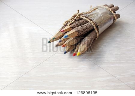 Wooden pencils on a white wooden table.