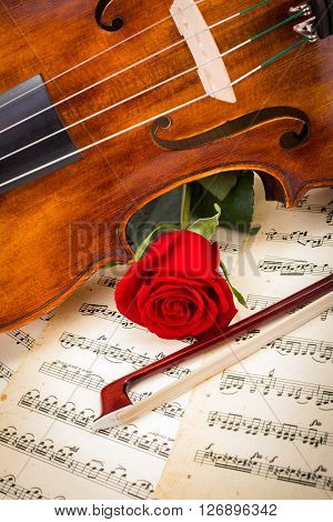 Violin, Red Rose And Bow On Score