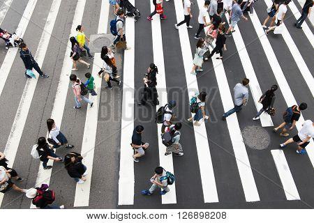 TAIPEI TAIWAN 22 MARCH 2014: Zebra pedestrian walking through the streets of Taipei on the road22 MARCH 2014 in taipeitaiwan