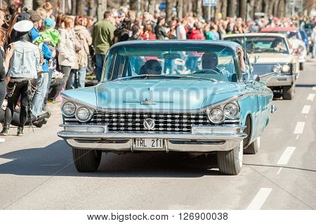 NORRKOPING, SWEDEN - MAY 1: Buick Le Sabre 1959 at classic car parade celebrates spring on May 1, 2013 in Norrkoping, Sweden. This parade is an annual tradition in Norrkoping on May Day.